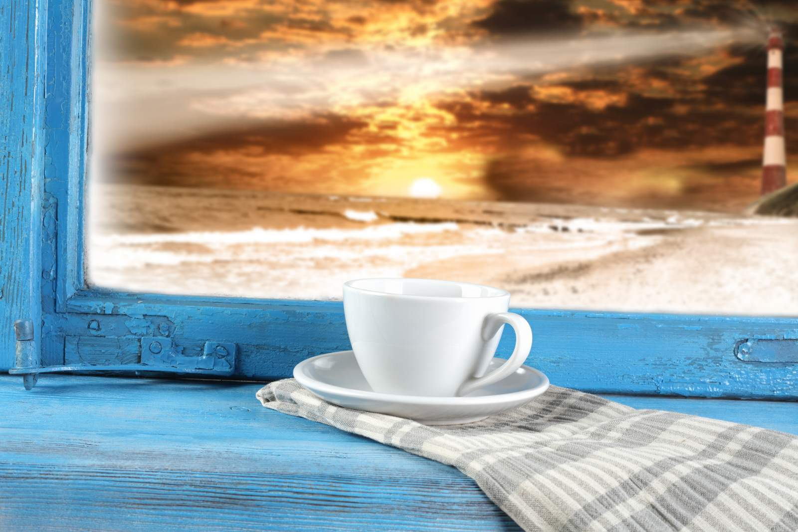 Cup of tea with sunset in background