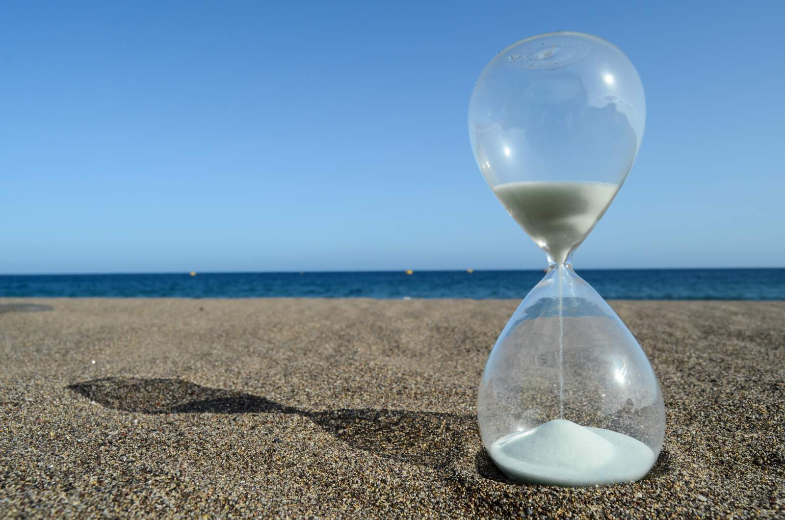 Hourglass on the beach